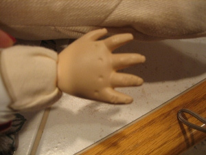 Repaired and cleaned new fingers on bisque doll.
