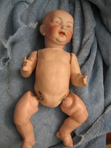 Bisque doll dirty and disjointed