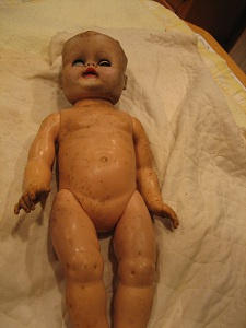 Entire doll needs cleaning.